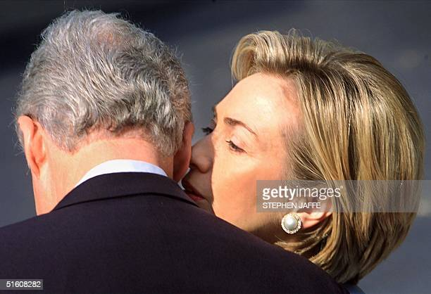 First Lady Hillary Rodham Clinton whispers to US President Bill Clinton prior to the arrival of Hungarian President Arpad Goencz on the South Lawn of...