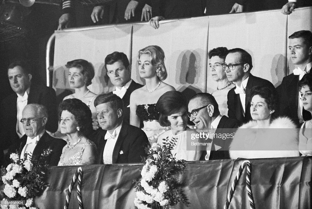 First Lady Jackie Kennedy speaks with Vice President Johnson in the presidential box during the inaugural ball Also in the box are President...