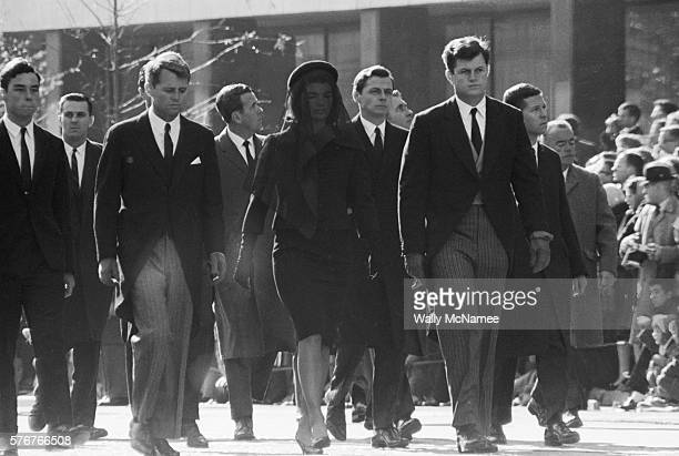 First Lady Jacqueline Kennedy walks from the White House to St Matthews Cathedral in the funeral procession for her husband President John Fitzgerald...