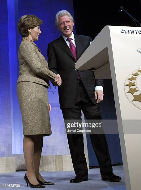 First Lady Laura Bush and former President Bill Clinton at the Opening Plenary of the Clinton Global Initiative 2006 at the Sheraton in New York City...
