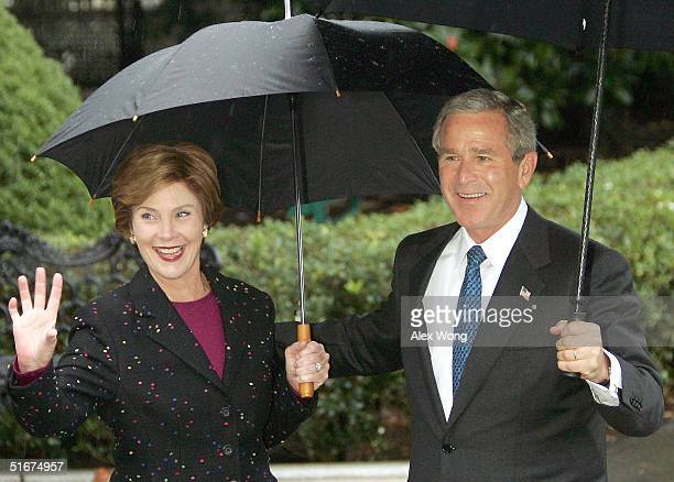 S first lady Laura Bush smiles with President George W Bush after she was wished a happy birthday as they depart from the White House November 4 2004...
