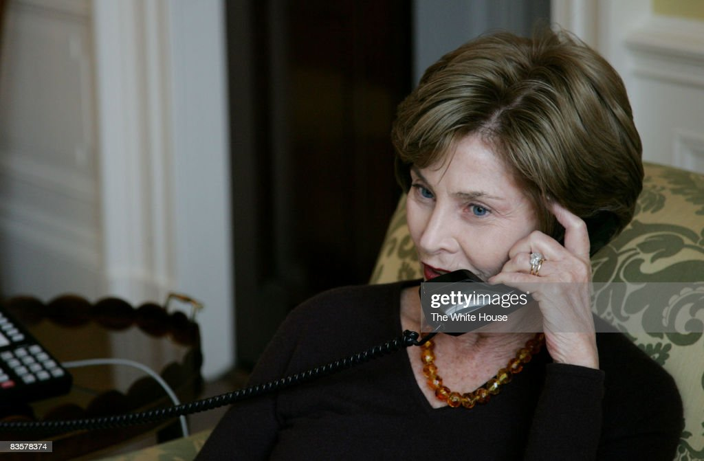 First lady Laura Bush talks to Michelle Obama, wife of President-elect Barack Obama, by telelphone at the White House November 5, 2008 in Washington, DC.