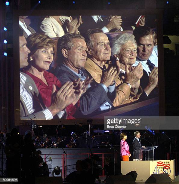 first lady Laura Bush US President George W Bush his father former President George HW Bush Barbara Bush and Florida Governor Jeb Bush are shown on a...