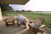 First Lady Laura Bush wife of President George W Bush is relaxing in an Adirondack chair April 11 2001 on the patio outside of the house at their...