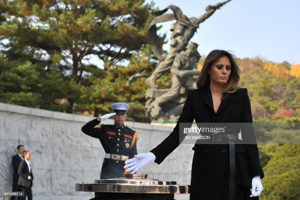 US First Lady Melania burns incense at the National Cemetery in Seoul on November 8, 2017. Trump offered North Korean leader Kim Jong-Un what he called 'a path towards a much better future' as tensions soar over Pyongyang's nuclear ambitions. /