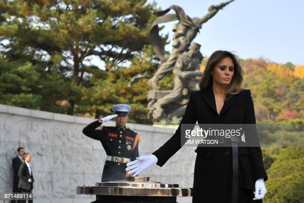 US First Lady Melania burns incense at the National Cemetery in Seoul on November 8 2017 Trump offered North Korean leader Kim JongUn what he called...