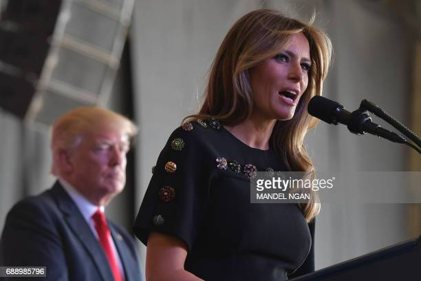 US First Lady Melania Trump address US military personnel and families at Naval Air Station Sigonella as US President Donald Trump stands on stage...