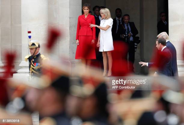 US First Lady Melania Trump and French president's wife Brigitte Macron talk as French President Emmanuel Macron and US President Donald Trump arrive...