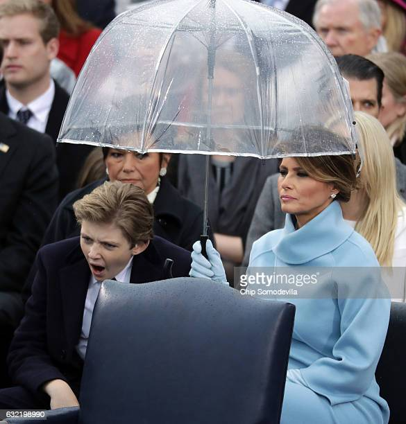 First lady Melania Trump and her son Barron Trump watch US President Donald Trump's inaugural address on the West Front of the US Capitol on January...