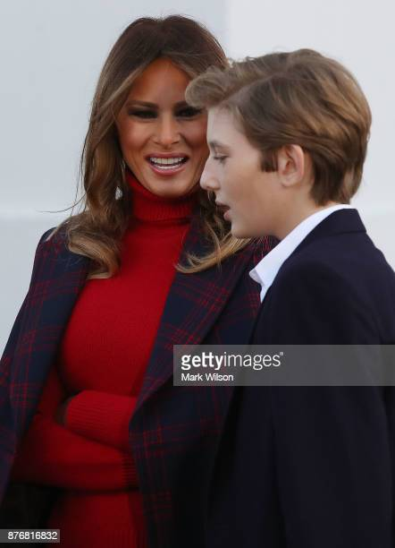 First lady Melania Trump and her son Barron welcome a 195foot balsam Fir that will serve as the official White House Christmas Tree at the White...