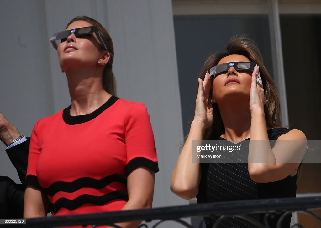First lady Melania Trump (R) and Ivanka Trump wear special glasses to view the solar eclipse at the White House on August 21, 2017 in Washington, DC. Millions of people have flocked to areas of the U.S. that are in the 'path of totality' in order to experience a total solar eclipse.