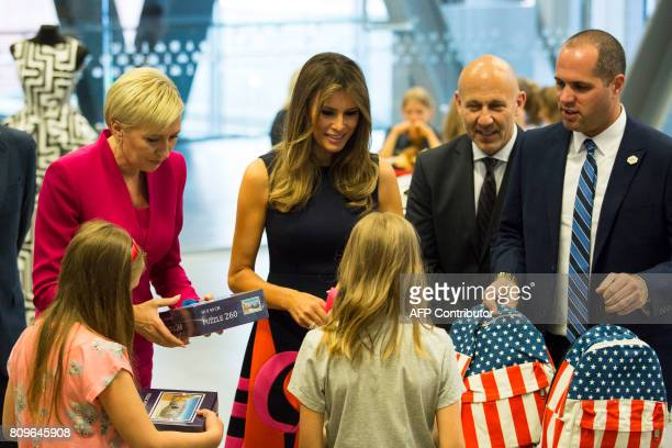First Lady Melania Trump and Polish President's wife Agata KornhauserDuda offer presents to children as they visit the Copernicus Science Center in...