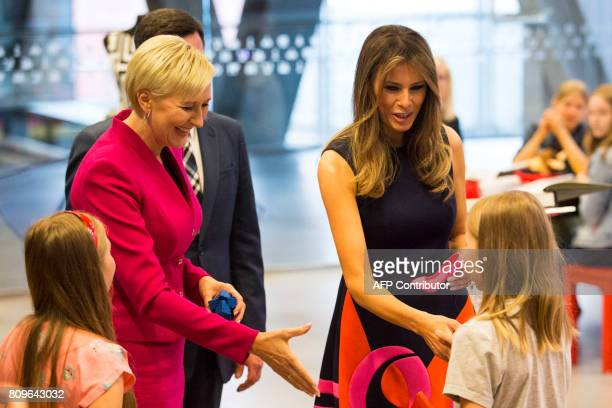 First Lady Melania Trump and Polish President's wife Agata KornhauserDuda show items printed by children on a 3D printer as they visit the Copernicus...