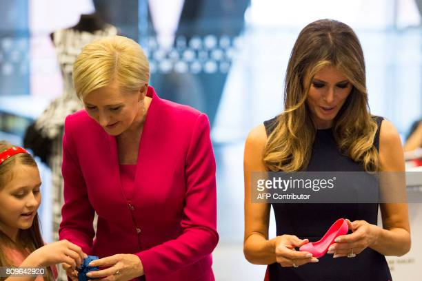 First Lady Melania Trump and Polish President's wife Agata KornhauserDuda show shoes printed by children on a 3D printer as they visit the Copernicus...