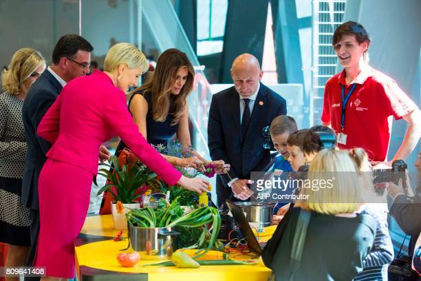 First Lady Melania Trump and Polish President's wife Agata KornhauserDuda talk with children as they visit the Copernicus Science Center in Warsaw on...
