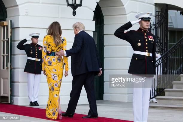 First Lady Melania Trump and President Donald Trump head back in to the White House after the departure of Prime Minister Narendra Modi of India as...
