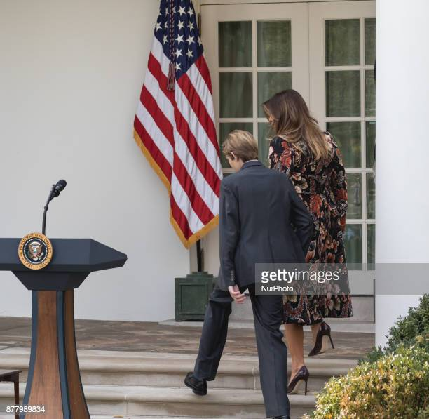 First lady Melania Trump and son Barron Trump follow behind President Donald Trump as they leave the Rose Garden after the pardoning of Drumstick at...