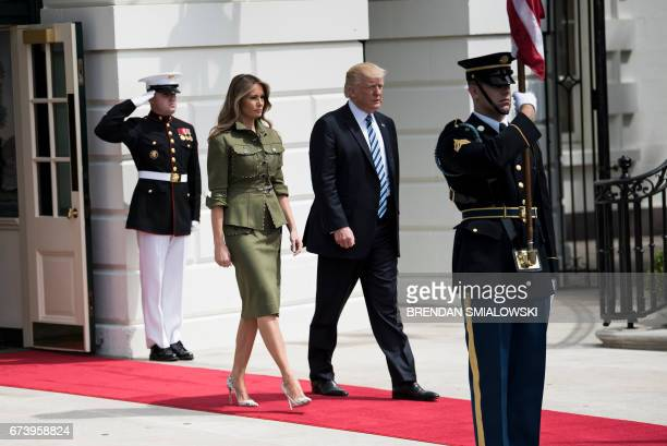 US First Lady Melania Trump and US President Donald Trump arrive to greet Argentina's President Mauricio Macri outside the White House April 27 2017...