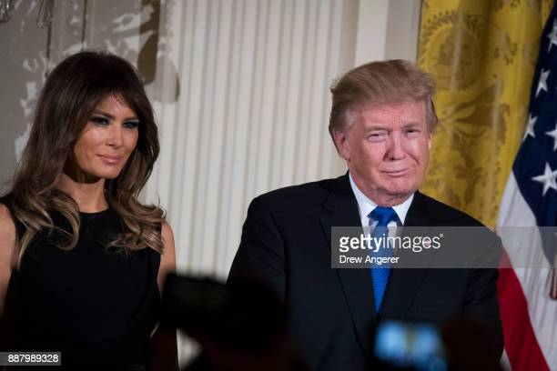 First lady Melania Trump and US President Donald Trump attend a Hanukkah Reception in the East Room of the White House December 7 2017 in Washington...