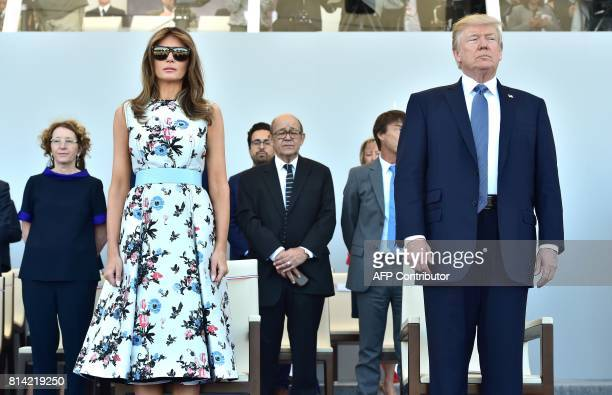 US First Lady Melania Trump and US President Donald Trump attend the annual Bastille Day military parade on the ChampsElysees avenue in Paris on July...