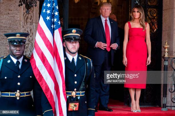 US First Lady Melania Trump and US President Donald Trump await the arrival of Chinese President Xi Jinping and his wife Peng Liyuan at the MaraLago...