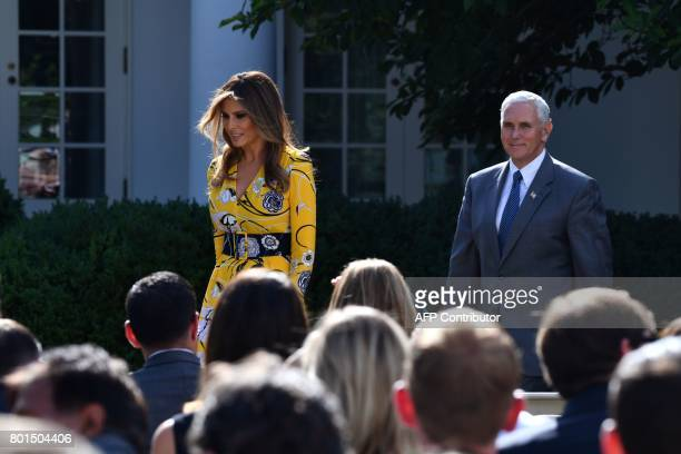 US First Lady Melania Trump and US VicePresident Mike Pence walk towards a press conference to be addressed by US President Donald Trump and Indian...