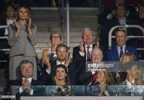 US first lady Melania Trump applauds the US team during the opening ceremonies of the Invictus Games in Toronto Ontario September 23 2017 / AFP PHOTO...