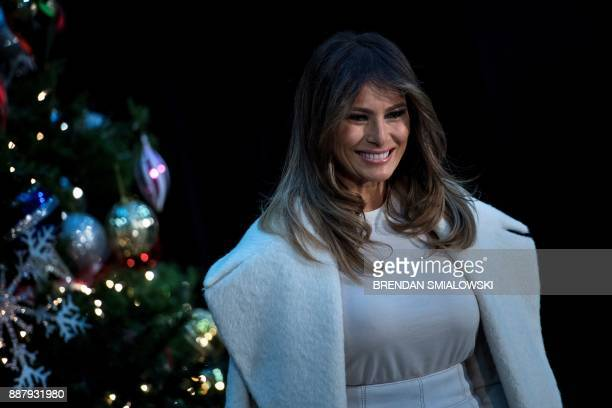 US first lady Melania Trump arrives for reading to young patients at Children's National Medical Center December 7 2017 in Washington DC / AFP PHOTO...