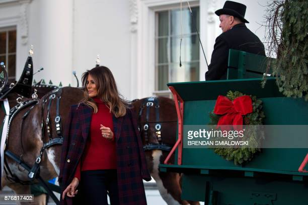 US first lady Melania Trump arrives to receive a Christmas tree during an event at the White House November 20 2017 in Washington DC / AFP PHOTO /...
