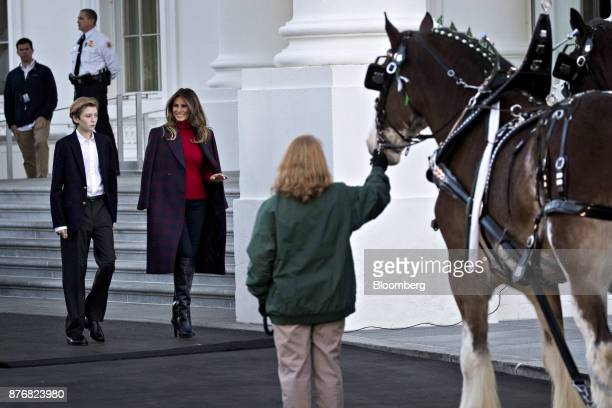 US First Lady Melania Trump center left and son Barron Trump arrive to view the White House Christmas Tree at the North Portico of the White House in...