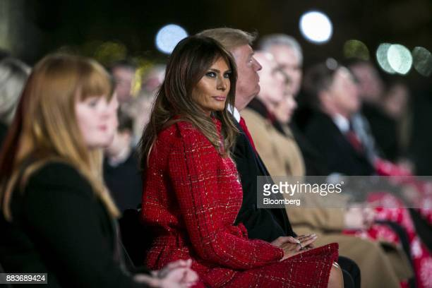 US First Lady Melania Trump center sits next to US President Donald Trump during the 95th Annual National Christmas Tree Lighting in Washington DC US...