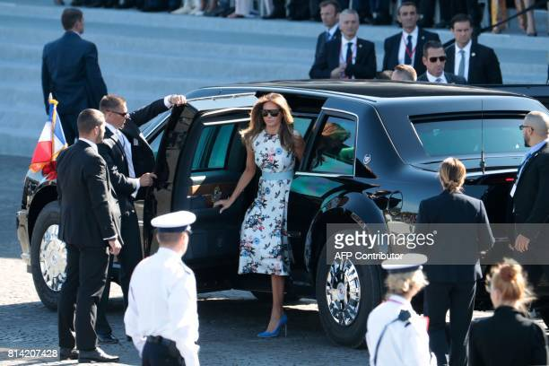 US First Lady Melania Trump gets out of a car as she arrives for the annual Bastille Day military parade on the ChampsElysees avenue in Paris on July...
