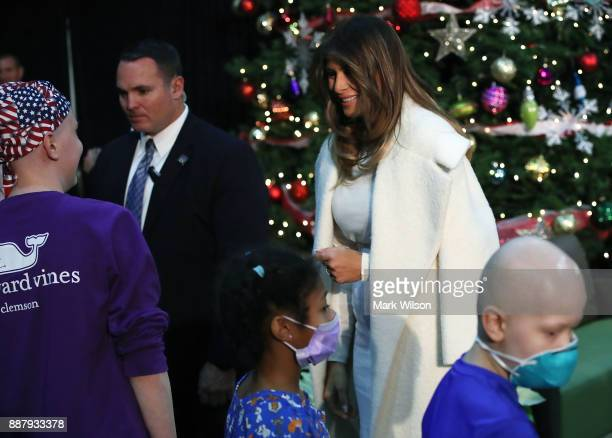 First lady Melania Trump greets children after reading the Christmas book The Polar Express at Children's National Medical Center on December 7 2017...
