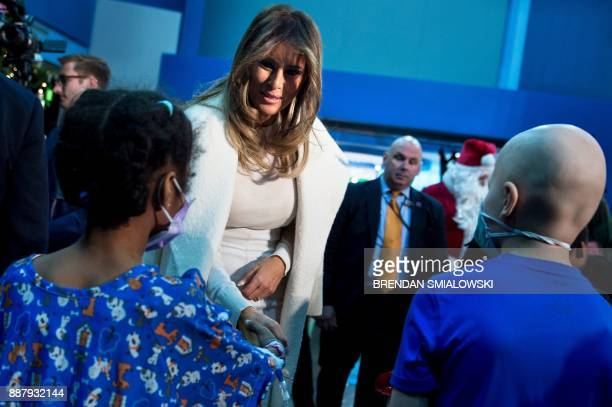 US first lady Melania Trump greets patients after reading to them at Children's National Medical Center December 7 2017 in Washington DC / AFP PHOTO...