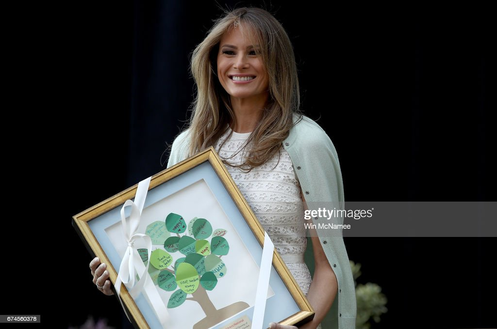 U.S. first lady Melania Trump hold a gift presented to her by 7-year-old Noah Haas before speaking at the Children's National Health System April 28, 2017 in Washington, DC. Trump spoke a the opening of the Bunny Mellon Healing Garden for patients and famlies, an outdoor location for to safely spend time outdoors while receiving treatment at the hospital.