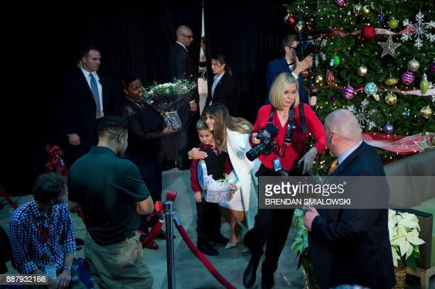 US first lady Melania Trump hugs a child after reading to patients at Children's National Medical Center December 7 2017 in Washington DC / AFP PHOTO...