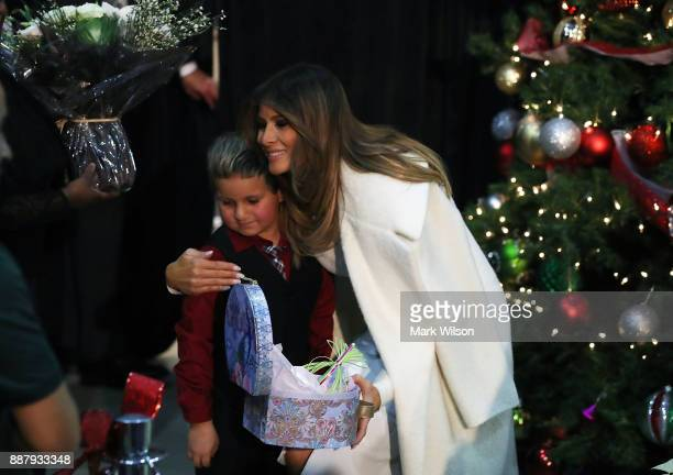 First lady Melania Trump hugs Damian Contreras during a visit to Children's National Medical Center on December 7 2017 in Washington DC First ladies...