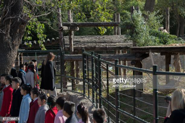 US First Lady Melania Trump interacts with children outside a panda enclosure during a visit to the Beijing Zoo in Beijing on November 10 2017 / AFP...