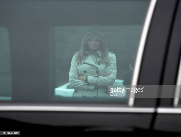 First lady Melania Trump is framed through the window of the limousine that was used by United States President Bill Clinton as she and US President...