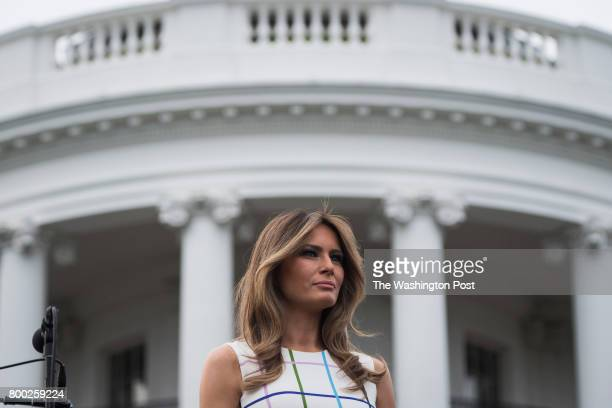 First Lady Melania Trump listens as President Donald Trump speaks during the Congressional Picnic on the South Lawn of the White House in Washington...