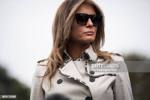 First lady Melania Trump listens as President Donald Trump speaks to reporters on the South Lawn of the White House speaks to reporters and members...