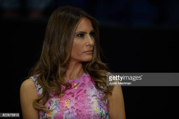First lady Melania Trump listens as US President Donald Trump addresses a rally at the Covelli Centre on July 25 2017 in Youngstown Ohio The rally...