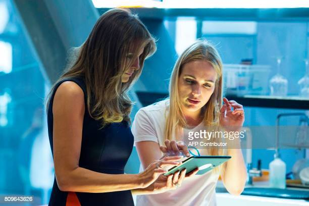 First Lady Melania Trump listens to a young girl as she visits the Copernicus Science Center with the Polish President's wife in Warsaw on July 6...