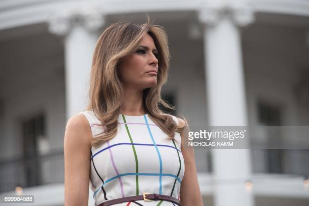 US First Lady Melania Trump listens to her husband President Donald Trump speak at the Congressional picnic at the White House in Washington DC on...