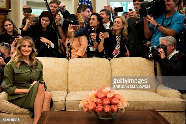US First Lady Melania Trump listens while US President Donald Trump speaks to the press before a meeting with Argentina's President Mauricio Macri in...