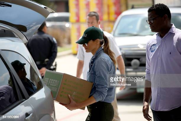 S first lady Melania Trump loads emergency supplies into the back of a minvan for residents impacted by Hurricane Harvey while visiting the First...