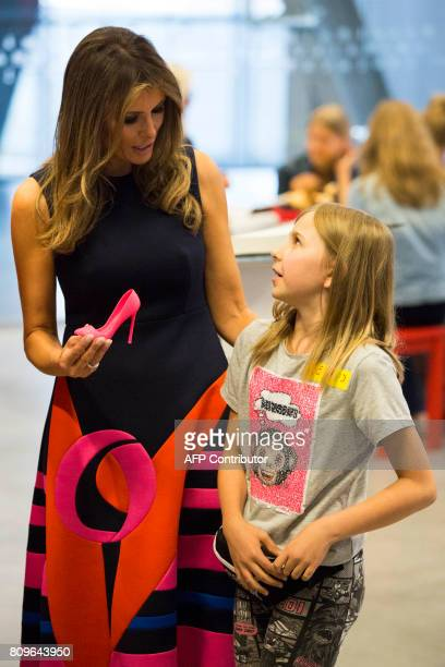 First Lady Melania Trump looks at a shoe printed on a 3D printer by a young girl as she visits the Copernicus Science Center with the Polish...
