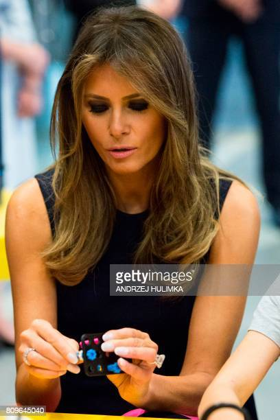 US First Lady Melania Trump looks at toys as she visits the Copernicus Science Center with the Polish President's wife in Warsaw on July 6 2017 US...
