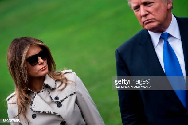 US first lady Melania Trump looks at US President Donald Trump holding a press point while walking to Marine One on the South Lawn of the White House...
