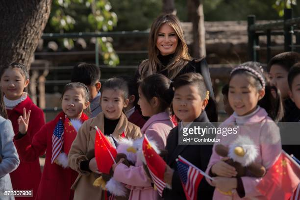 US First Lady Melania Trump poses for a photograph after she presented stuffed toy eagles from the US to children at the Beijing Zoo in Beijing on...